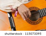 closeup on hand and guitar - stock photo