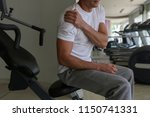 man with shoulder pain in gym.... | Shutterstock . vector #1150741331