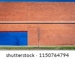 a red brick wall with a white... | Shutterstock . vector #1150764794