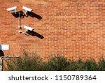 three security cameras arranged ... | Shutterstock . vector #1150789364