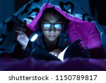 girl holding flashlight while... | Shutterstock . vector #1150789817