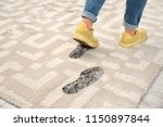 person in dirty shoes leaving... | Shutterstock . vector #1150897844
