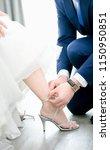 closeup of groom putting shoes... | Shutterstock . vector #1150950851
