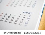 august calendar page with... | Shutterstock . vector #1150982387