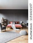 pouf and carpet in dark grey... | Shutterstock . vector #1151023157