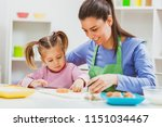 happy mother and daughter are... | Shutterstock . vector #1151034467