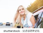 young pretty woman driving car... | Shutterstock . vector #1151059151