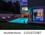 modern villa with colored led...   Shutterstock . vector #1151072387