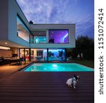modern villa with colored led... | Shutterstock . vector #1151072414