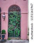 rainbow row street in... | Shutterstock . vector #1151161967