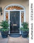 rainbow row street in... | Shutterstock . vector #1151161994