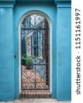 rainbow row street in... | Shutterstock . vector #1151161997