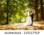 wedding shot of bride and groom ... | Shutterstock . vector #115117519
