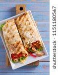 chicken caesar salad wraps with ... | Shutterstock . vector #1151180567