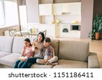 woman is sitting with her kids... | Shutterstock . vector #1151186411