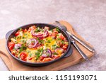 shakshuka with bread toasts in... | Shutterstock . vector #1151193071