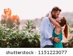 young couple in love enjoying... | Shutterstock . vector #1151223077