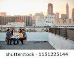 Friends Sitting On Rooftop...