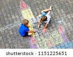 two little kids boys drawing... | Shutterstock . vector #1151225651
