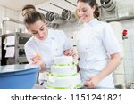 two pastry bakers decorating... | Shutterstock . vector #1151241821