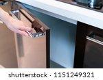 Stock photo hand open kitchen cabinet 1151249321