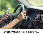 women driver with a cell phone... | Shutterstock . vector #1151301767