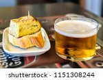 glass of beer and spanish... | Shutterstock . vector #1151308244