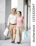aged vietnamese couple walking... | Shutterstock . vector #1151322047