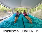 bare footed children laying on... | Shutterstock . vector #1151347244