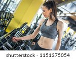 smiling young woman choosing...   Shutterstock . vector #1151375054