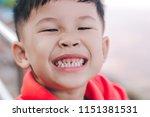 close up of happy kid is... | Shutterstock . vector #1151381531