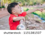 kid boy pointing with finger ... | Shutterstock . vector #1151381537