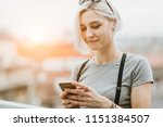 young hipster woman using... | Shutterstock . vector #1151384507