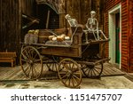 An Old Carriage With Two...