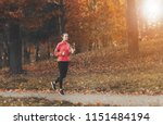 attractive woman jogging.... | Shutterstock . vector #1151484194