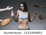 lean woman refuses to eat.... | Shutterstock . vector #1151496851