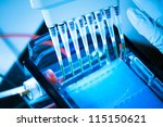 Small photo of loading amplified DNA samples to agarose gel with multichannel pipette