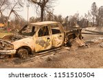 charred truck in front of home... | Shutterstock . vector #1151510504