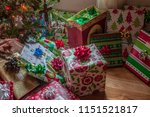 colorful wrapped gifts under... | Shutterstock . vector #1151521817