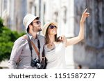 young couple of turists in the... | Shutterstock . vector #1151587277
