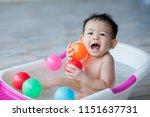 little boy playing bathing... | Shutterstock . vector #1151637731