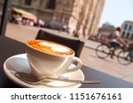 cappuccino coffee on the table... | Shutterstock . vector #1151676161