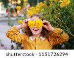 child with flowers eyes showing ... | Shutterstock . vector #1151726294