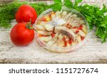 Stock photo slices of the pickled atlantic herring fillet in marinade of vegetable oil and red pepper in round 1151727674