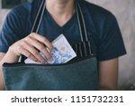 girl's hands holding baht bills ...   Shutterstock . vector #1151732231