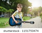 child boy playing on guitar in...   Shutterstock . vector #1151753474
