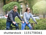 young couple riding bicycle...   Shutterstock . vector #1151758361