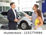 young couple choosing new car... | Shutterstock . vector #1151774984