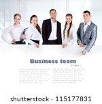 Business Team Holding The...