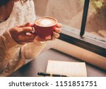 woman holding a coffee cup and... | Shutterstock . vector #1151851751